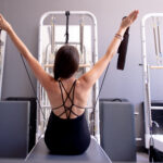 women on reformer back view modern pilates