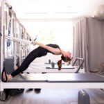 woman in Pilates studio on tower